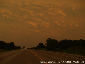 Sunset illuminates the departing storm; empty lanes heading into Joplin